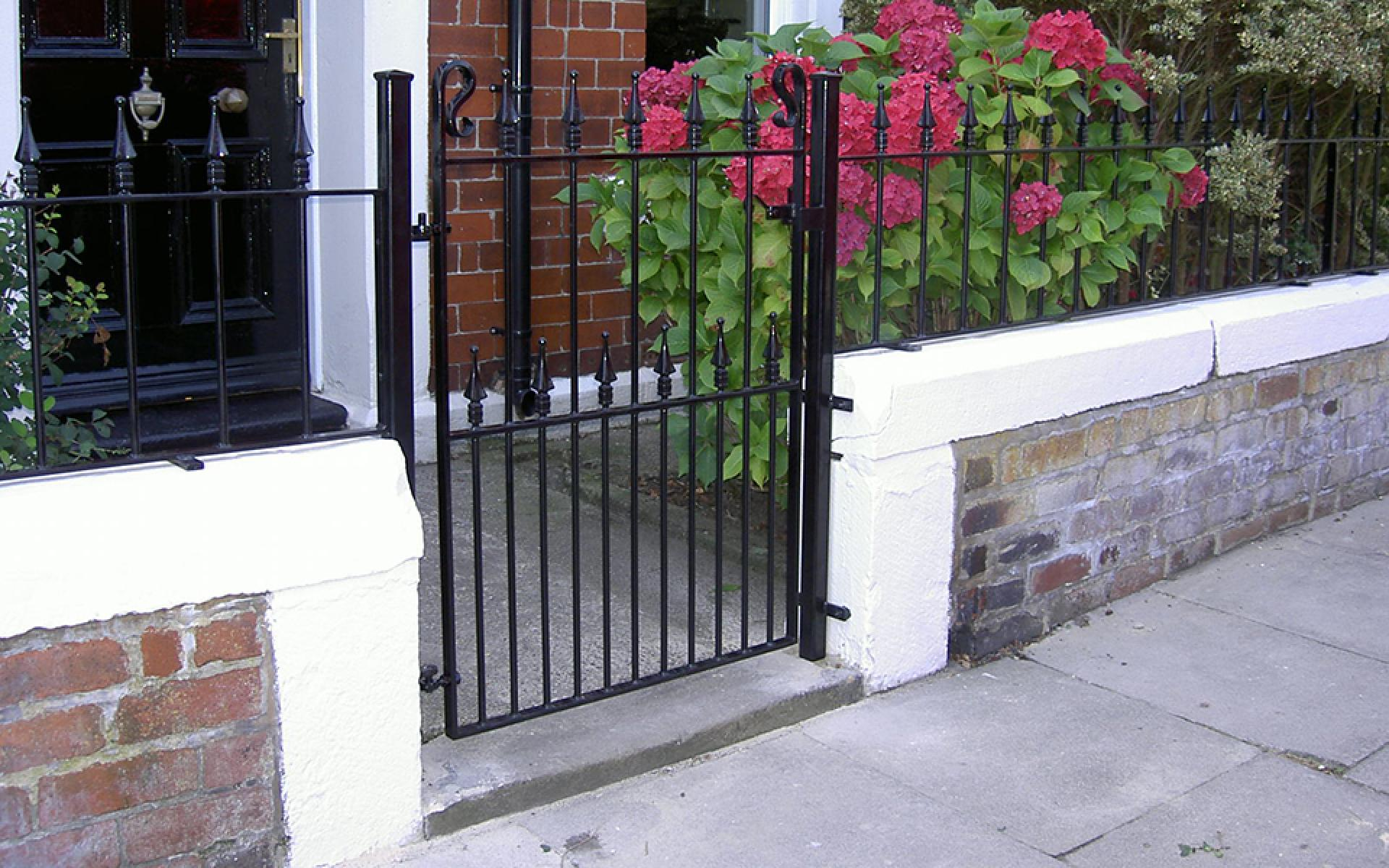 Wrought iron pedestrian garden gate and railings
