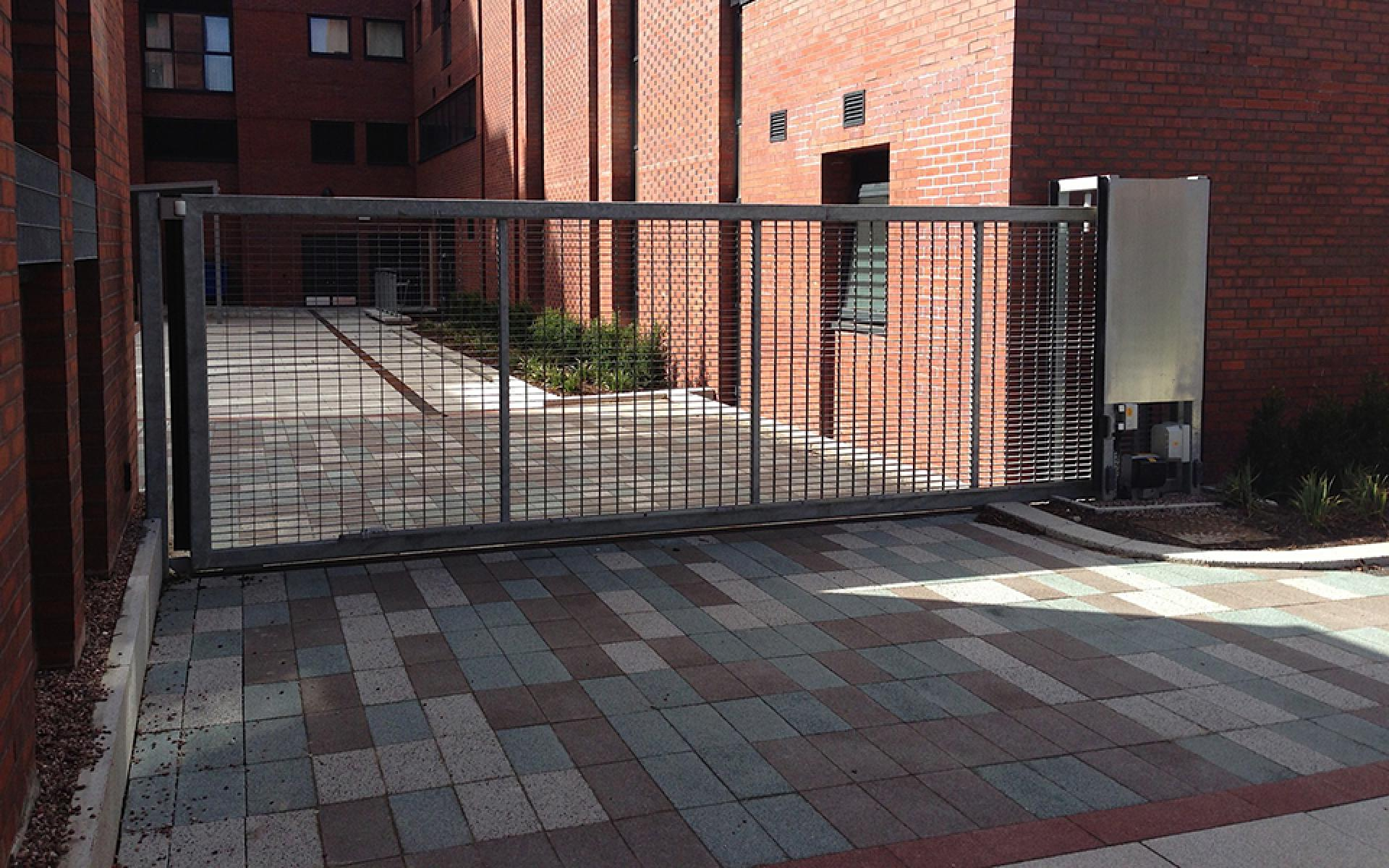 Metal gate with sliding automation (Courtesy of J3)