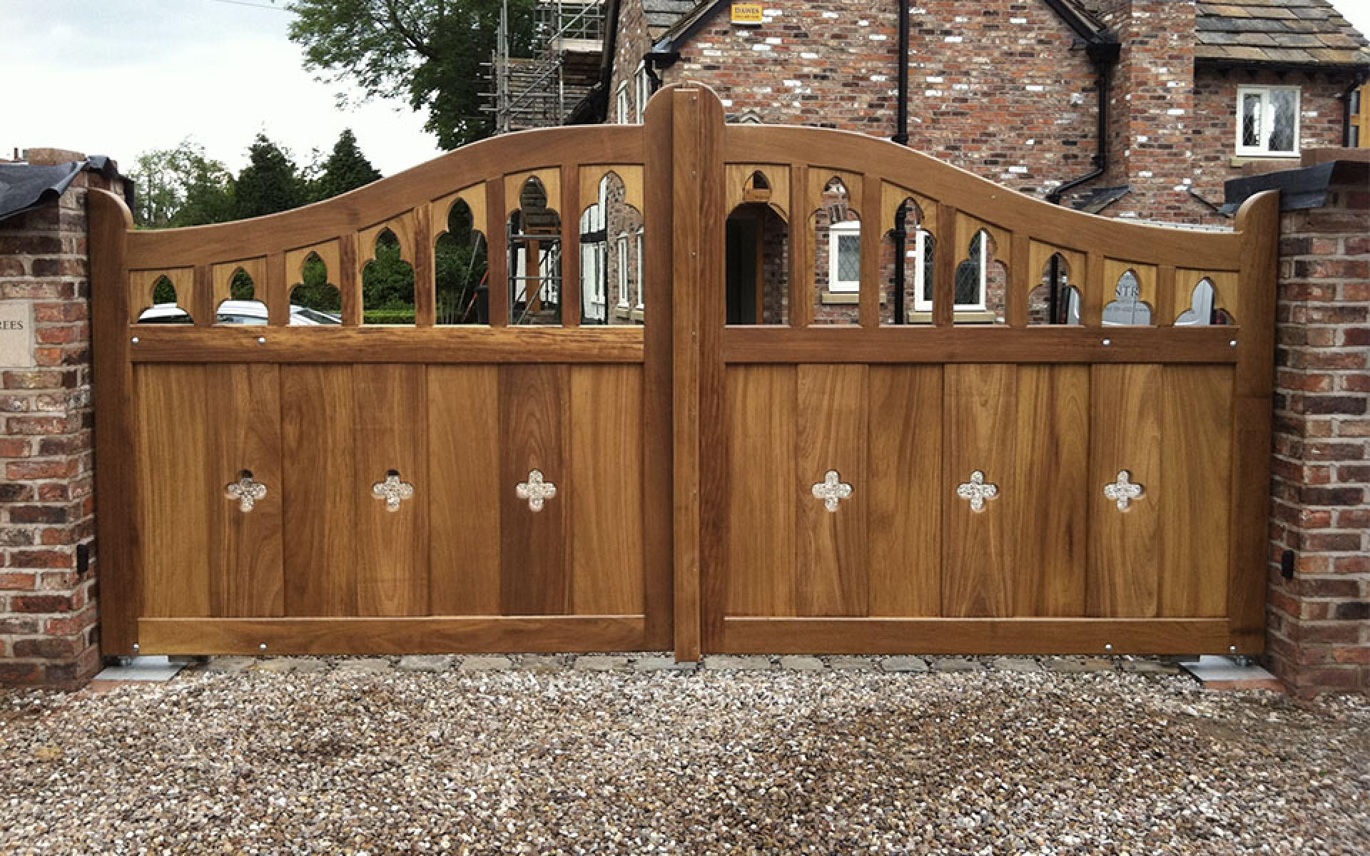 The Mobberley Cathedral Arch iroko gate with underground automation (Courtesy of Country Gates)