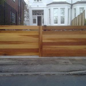 Contemporary cedar sliding gates (Courtesy of Country Gates)